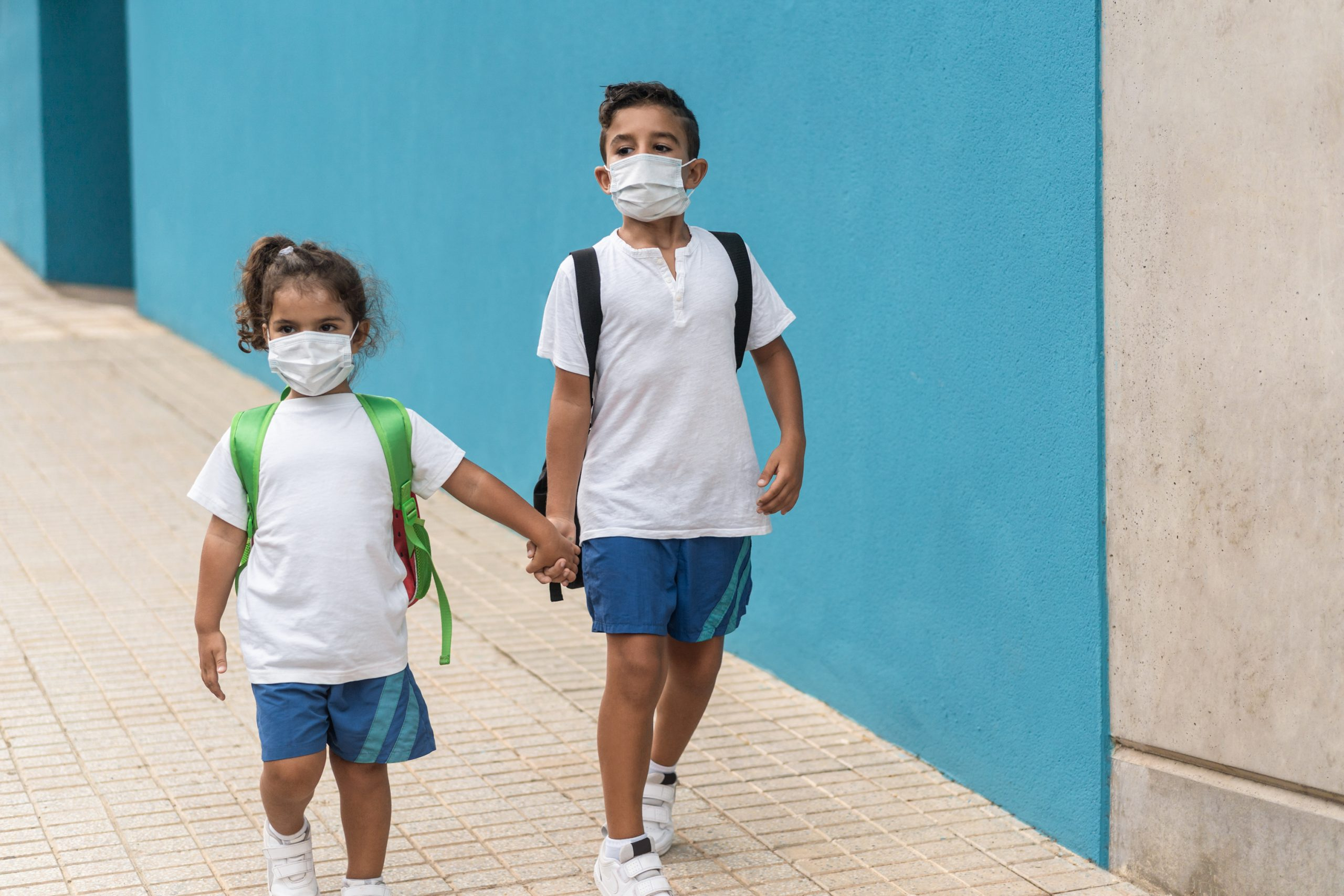 Children With Face Mask Going Back To School During Coronavirus Outbreak Focus On Boy Face